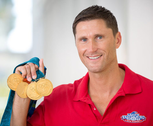 Olympic Gold Medalist holding 4 Medals Lenny Krayzelburg