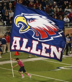 Man holding flag running on football field